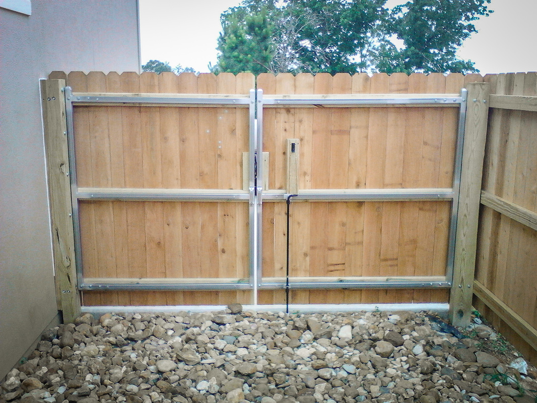 Wood privacy fences kistler fence double drive gate w metal frame inside baanklon Image collections